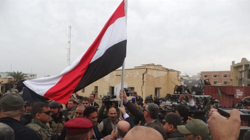 Iraqi Prime Minister Haider al-Abadi raised an Iraqi flag in Ramadi a day after the army retook the city centre from ISIL [Reuters]