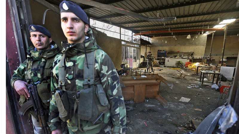 Soldiers stand guard after a suicide attack in the northern port city of Tripoli, Lebanon [Hussein Malla/AP]