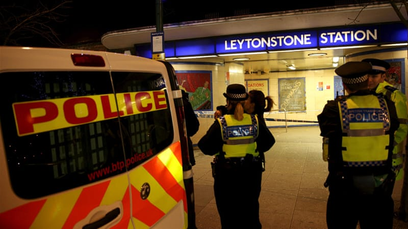 Police officers investigate the crime scene at Leytonstone underground station in east London [Neil Hall/Reuters]