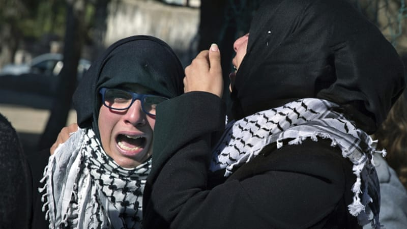 Palestinians mourn at the funeral of Abdulrahman Wajih Barghouti, 27, in the West Bank village of Aboud [Nasser Nasser/AP]