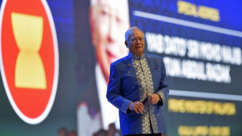 Najib reshuffled his cabinet and removed those most vocal about corruption claims [Susan Walsh/AP]