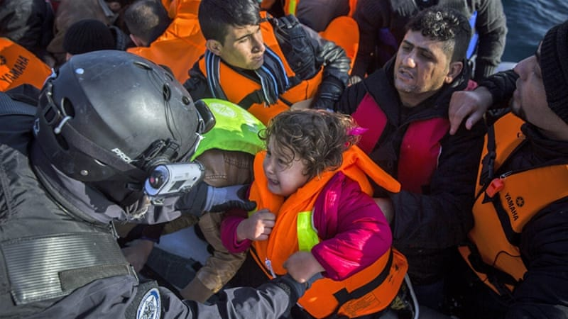 Members of the European Border Protection Agency from Portugal rescue 56 people off the Greek island of Lesbos on Tuesday [AP]
