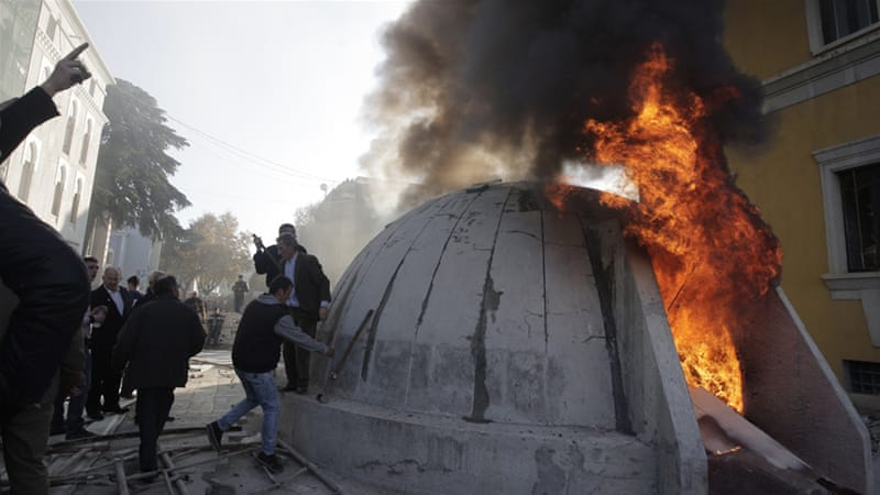 Opposition protesters set fire to a bunker installed as an artwork near the interior ministry [Armando Babani/EPA]
