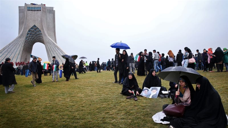 Iranians attend a rally commemorating the 36th anniversary of the Islamic revolution under Azadi Tower, Tehran [AP]