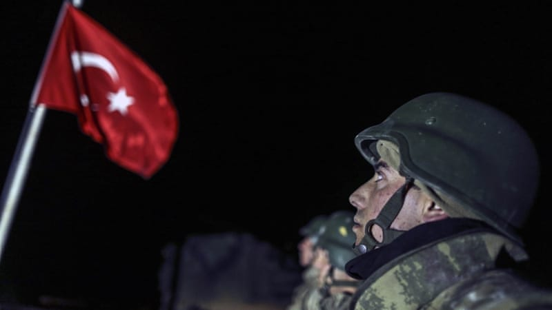 The Turkish flag is raised in the Eshme region of Aleppo where the Tomb of Suleyman Shah will be placed [Getty]