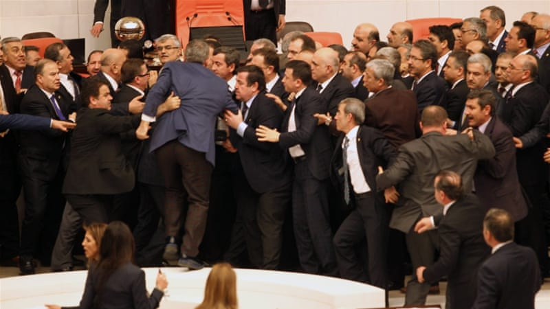 Turkish lawmakers scuffle during a debate on a new security bill [AFP]