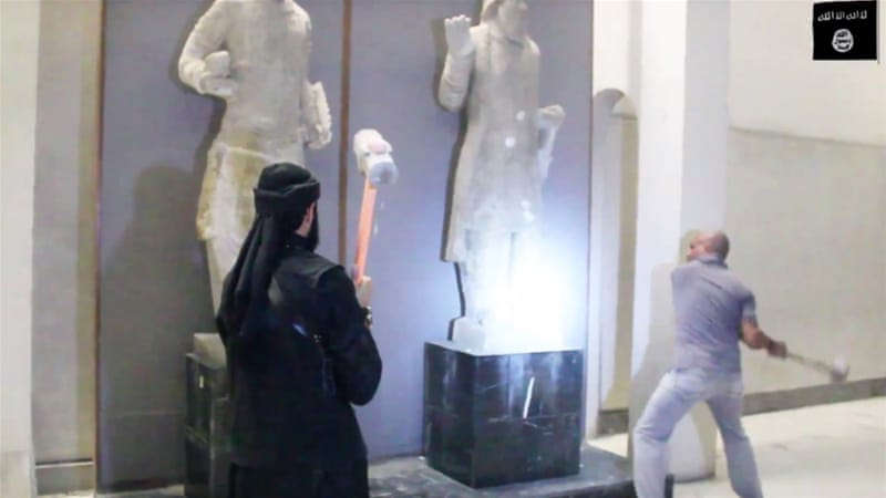 The video shows fighters using sledgehammers to smash ancient artifacts in the northern city of Mosul [AP]