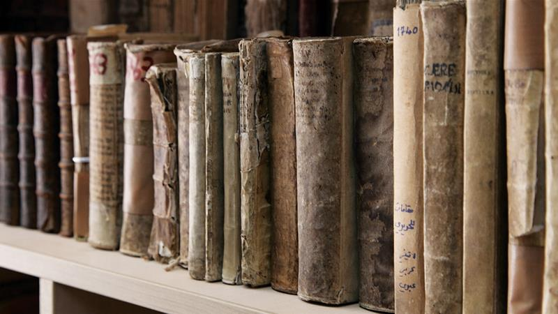 Books rescued from Mosul are displayed at the Dominican Priory in Qaraqosh, Iraq [AP]