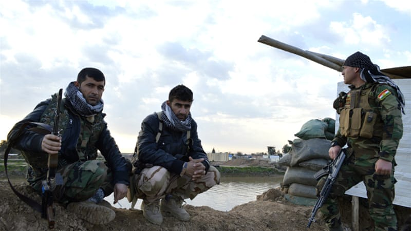 Peshmerga fighters watch ISIL positions in Maktab Khalid area, southwest of Kirkuk city. [Mohammed A Salih/Al Jazeera]