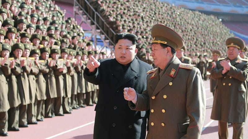 "Kim Jong-un (L) reportedly called for the production of ""more tactical guided weapons of high precision"" [Reuters]"