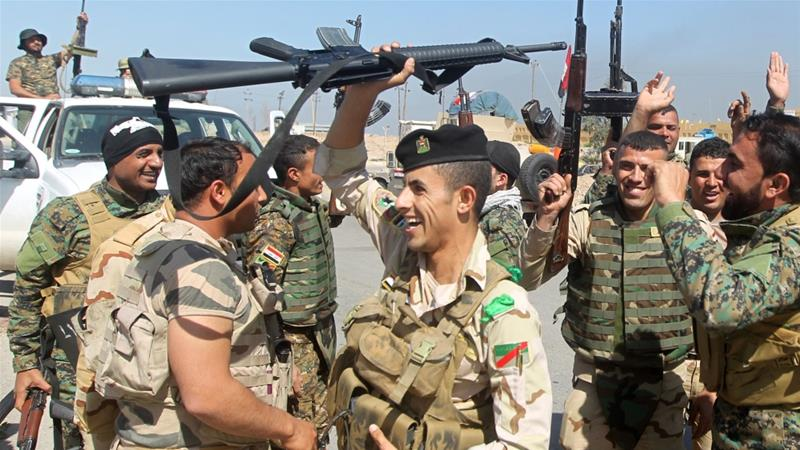 The advance of government forces and Shia militias into Sunni Tikrit has ignited sectarian tensions [AFP]