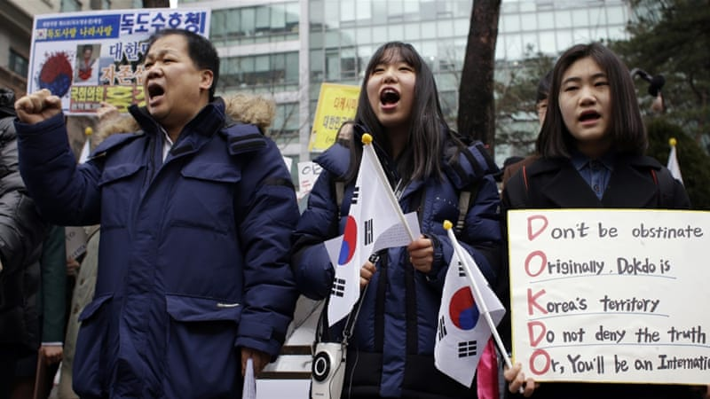 South Korean students and members of civic group shout slogans during a rally against Japan's Takeshima Day in front of the Japanese embassy in Seoul [AP]
