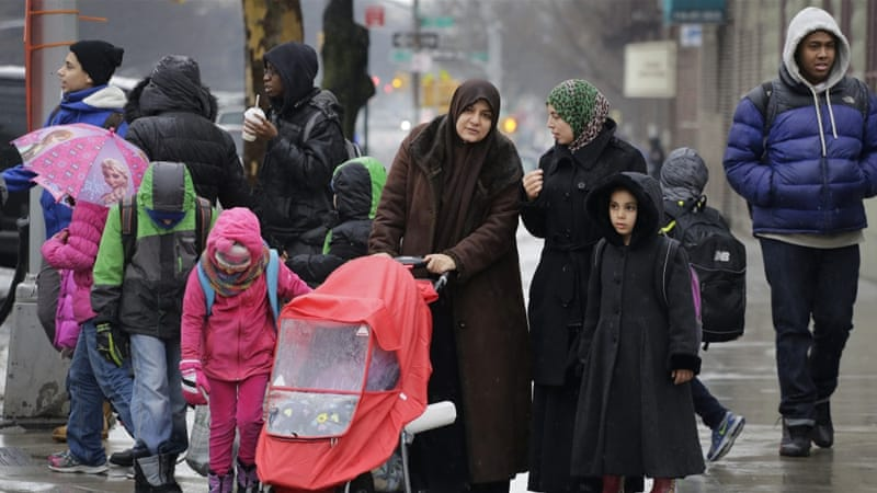 Muslim women accompany their children at the end of a school day in New York [AP]