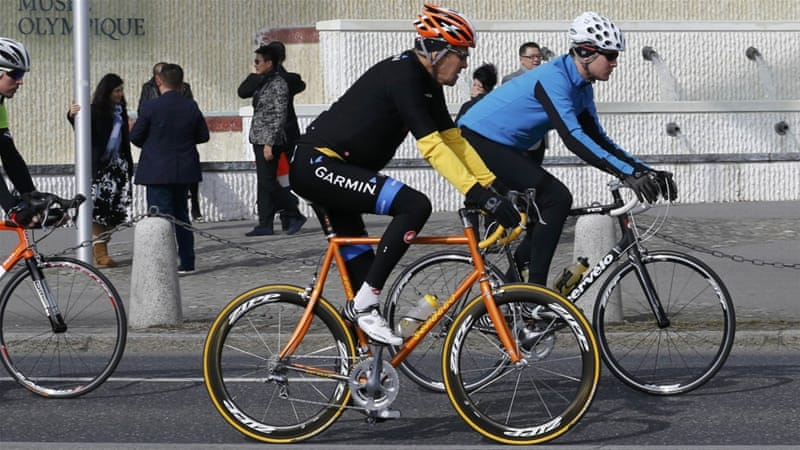 Kerry, pictured cycling in Lausanne on Monday, says there are 'important gaps' in the two sides' negotiating positions [AP]