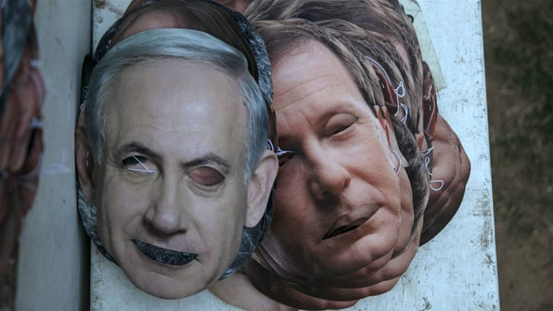 Masks depicting Netanyahu and Herzog lie on the ground after an Election Race at the Yarkon park in Tel Aviv [REUTERS]