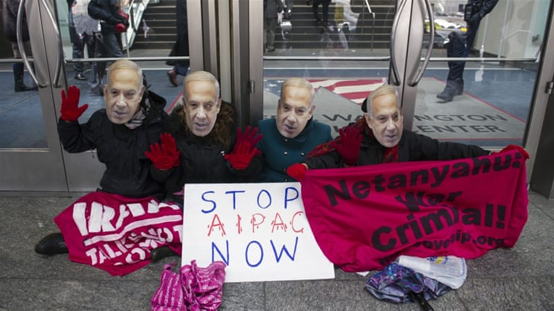 Pro-Palestine demonstrators wearing Netanyahu masks protest in front of the Washington Convention Center [AP]