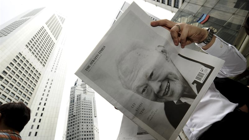 A man reads a newspaper bearing Lee Kuan Yew's image in Singapore [REUTERS]