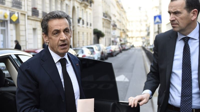 Nicolas Sarkozy arrives to take part in a meeting at UMP party headquarters in Paris [AFP]