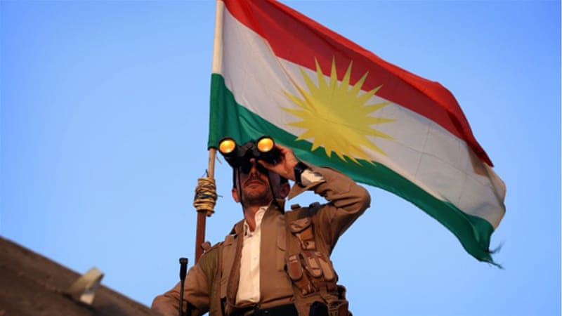 A Kurdish peshmerga fighter holds a position on the front line south of Erbil [Getty]