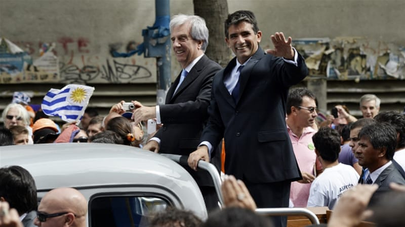 Vazquez and his vice president, Raul Sendic, wave to the crowd after Vazquez was sworn in as Uruguay's new president [Reuters]