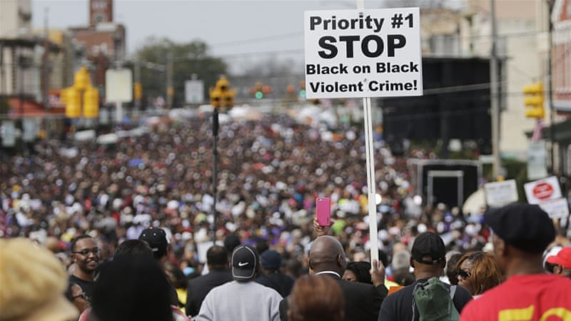 Crowds of people walk towards Selma after taking a symbolic walk across the Edmund Pettus Bridge [AP]