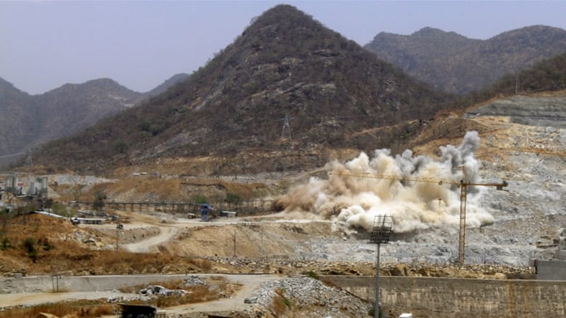 A cloud of dust rises from a dynamite blast as part of construction work at Ethiopia's Grand Renaissance Dam [REUTERS]