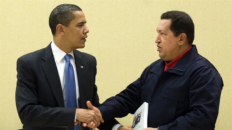 Hugo Chavez gives 'The Open Veins of Latin America' by Uruguayan writer Eduardo Galeano to Barack Obama [AFP]