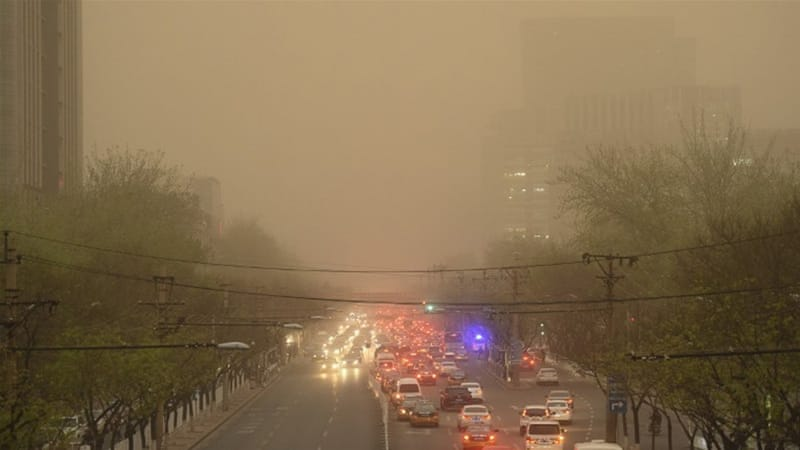 Beijing faces an increasing dust storm [AFP]
