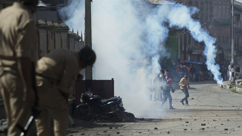 Police fired tear gas and rubber bullets to disperse hundreds of demonstrators in Kashmir on Friday [AP]