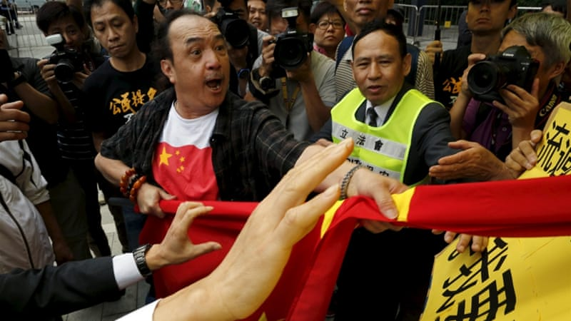 Rival protesters scuffled outside the Legislative Council as the plan was announced [Reuters]