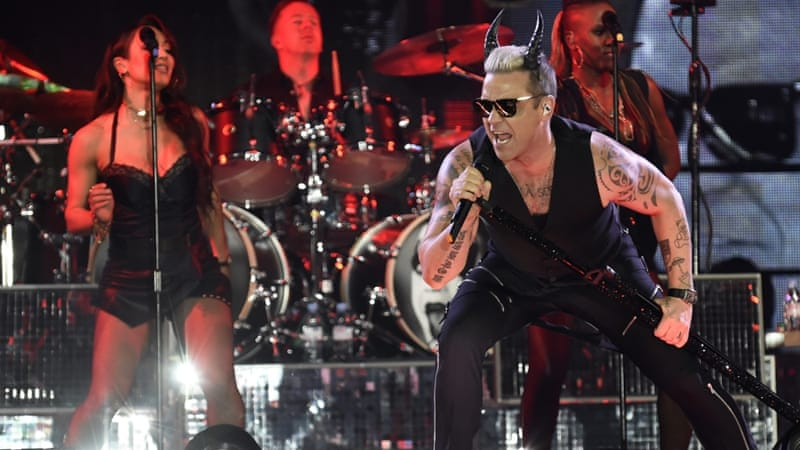 British singer Robbie Williams performs during a concert in Linz, Austria [EPA]