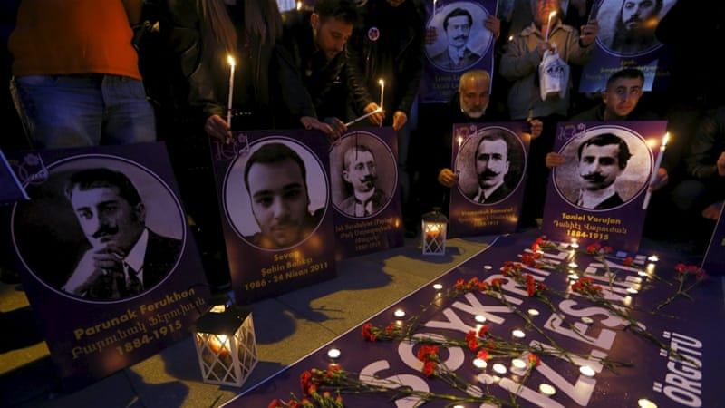 Demonstrators hold candles and pictures of Armenian victims during a commemoration of the mass killings of Armenians in Istanbul [Reuters]