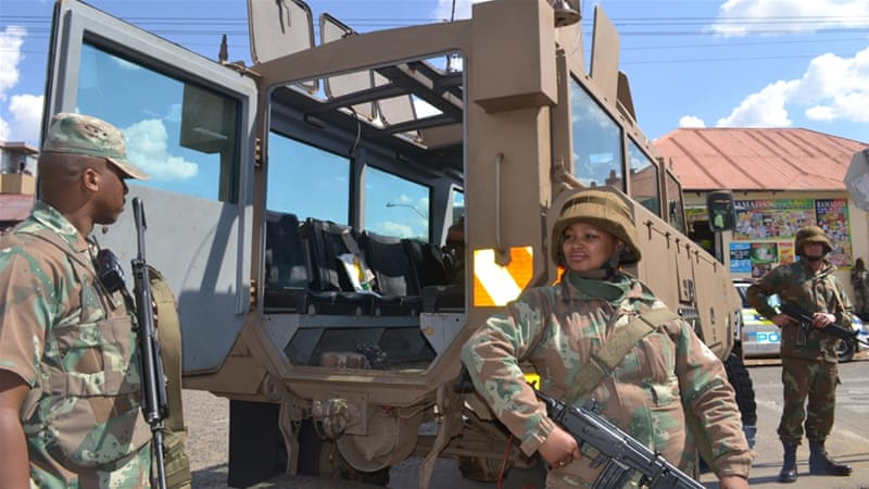 Police were joined by members of the South African Defence Force and immigration officials in the raids [Khadija Patel]