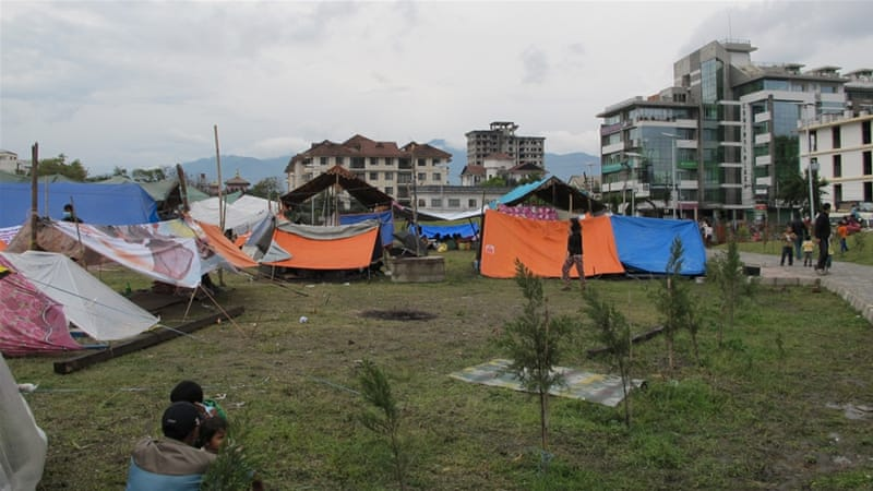 A magnitude-7.8 earthquake shook Nepal, killing at least 4,700 people and forcing many to seek shelter in makeshift tents [Annette Ekin/Al Jazeera]