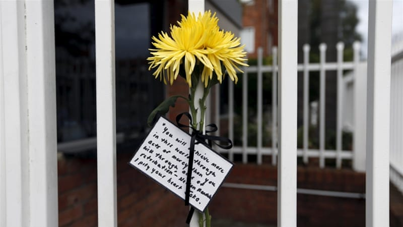 A flower and quote attributed to Nelson Mandela is tied to the front fence of Indonesia's consulate in Sydney, Australia [Reuters]