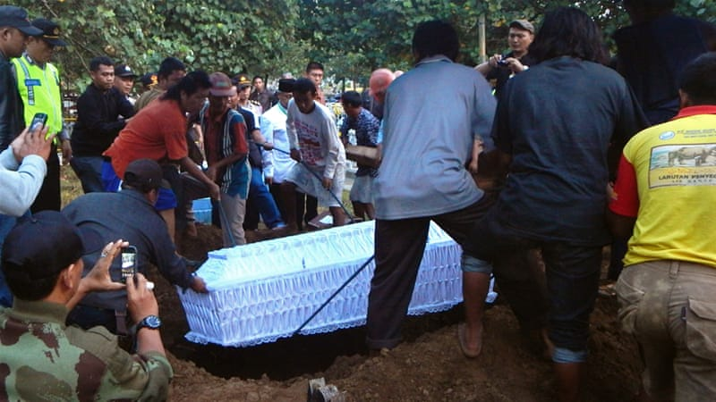 A coffin bearing the body of Indonesian drug convict Zainal Abidin was buried in Cilacap several hours after his execution [AFP]