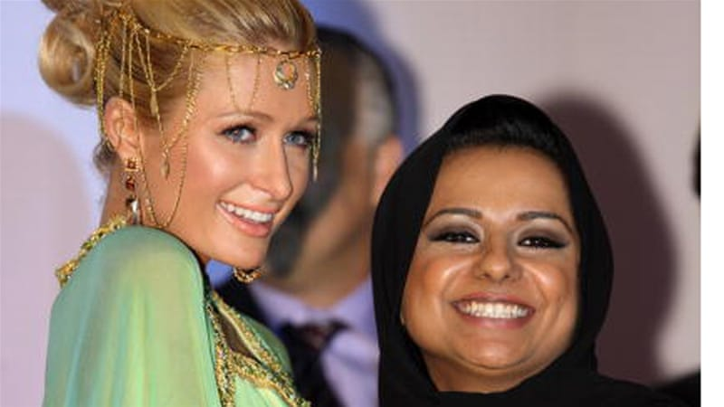Nayla al-Khaja with Paris Hilton at a press conference to promote the Dubai version of Hilton's television show [Getty]