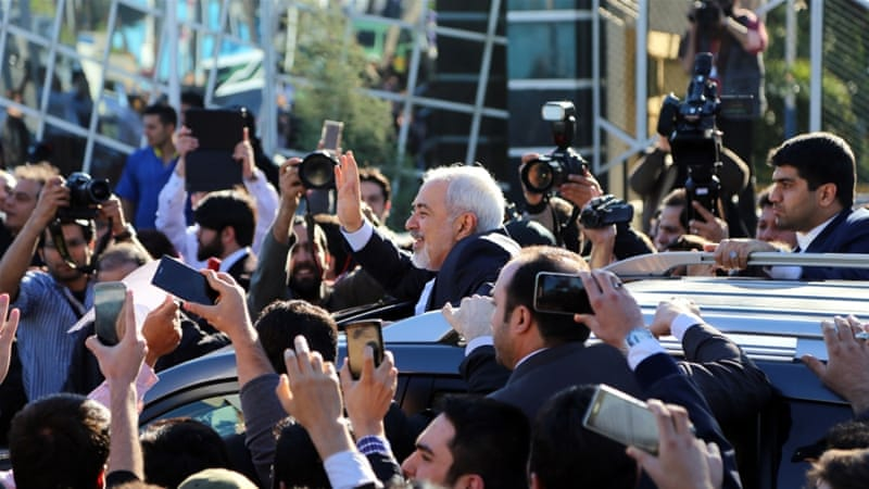 Iran's nuclear negotiating committee arrive in Tehran [Getty]