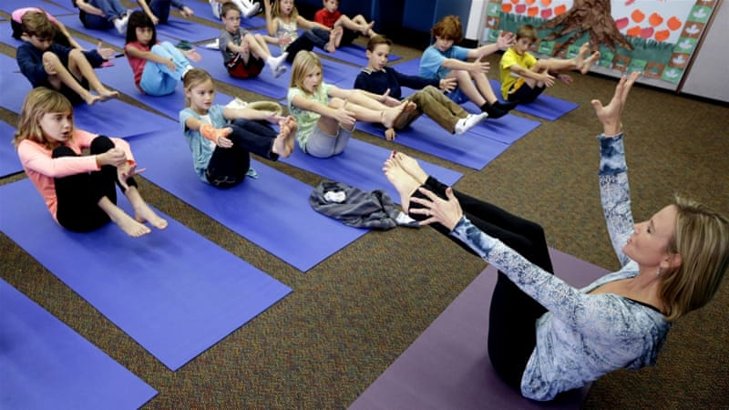 A grant from a nonprofit foundation provides twice-weekly yoga classes to the California school district's 5,600 students [File: AP]