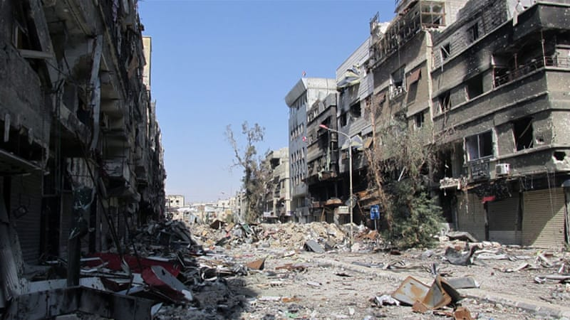 Yarmouk, once a thriving district, has been heavily devastated after being besieged by government forces for more than one year [AFP]