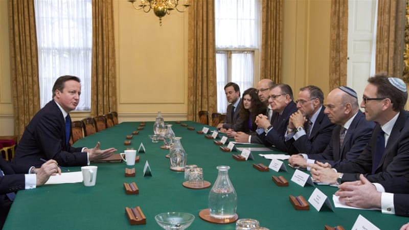 British PM David Cameron talks with members of the Jewish Leadership Council [AP]