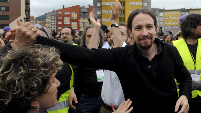 Iglesias waves as he arrives at an electoral meeting in Oviedo, Spain [REUTERS]
