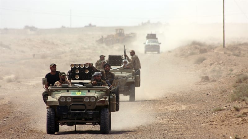 Iraqi security forces deploy northwest of Baghdad, during an operation aimed at cutting off ISIL in Anbar [AFP]