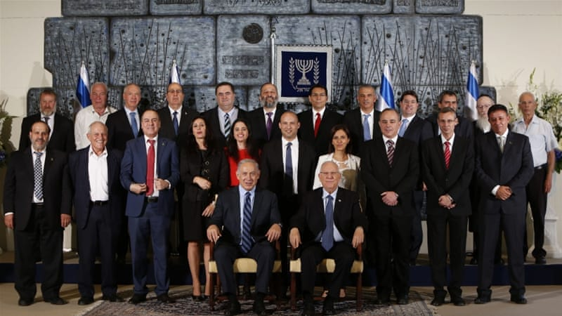 Members of the new Israeli government at the presidential compound in Jerusalem [Getty]