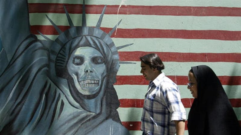 An anti-US mural painting outside the former US embassy in Tehran [AFP]