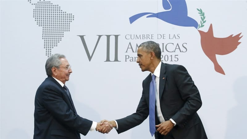 Obama shakes hands with Cuba's President Raul Castro in Panama [REUTERS]
