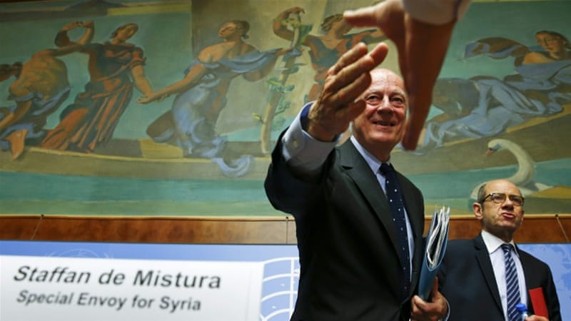 Staffan de Mistura shakes hands with a journalist after his news conference at the UN in Geneva [REUTERS]
