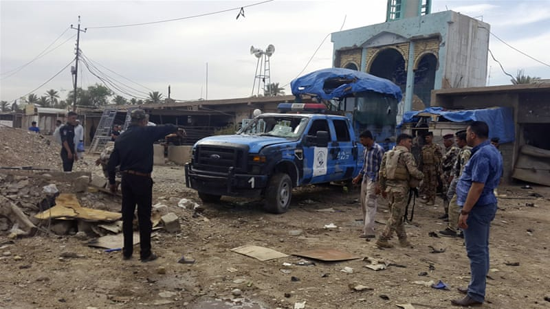Iraq security forces inspect the site of a car bomb attack in Balad Ruz in the eastern province of Diyala [Reuters]