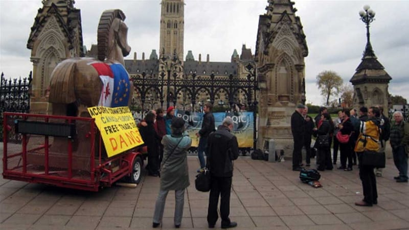 Activists in front of the Canadian parliament protest against negotiations between Canada and the EU on a free trade deal [AFP]