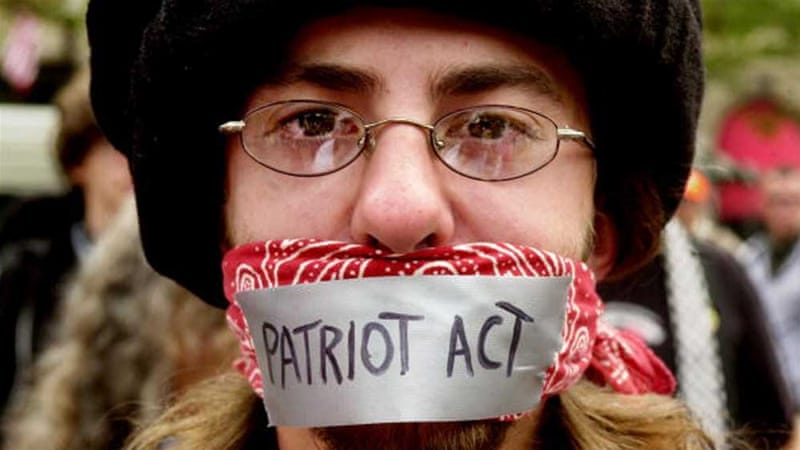 A man protests against the Patriot Act during an anarchist rally on the final day of the Democratic National Convention in 2004 [Getty]